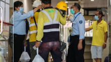Coronavirus: Hong Kong workers have lunch indoors amid heatstroke warning, a day after braving the sun and rain for their meal