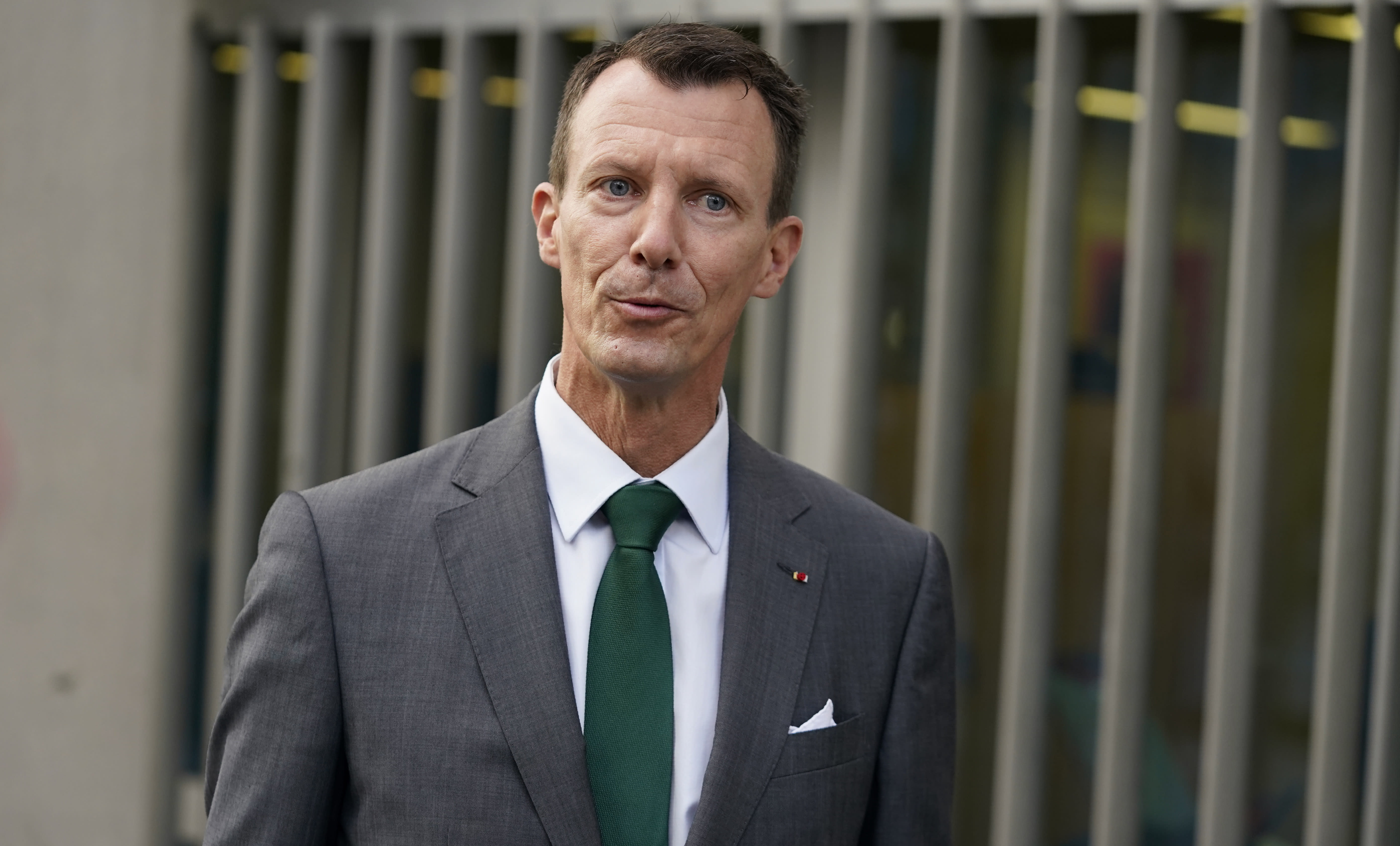 """Denmark's Prince Joachim walks to work, at the Danish Embassy in Paris, France, Friday, Sept. 18 2020. Prince Joachim, the younger son of Queen Margrethe of Denmark, who underwent an emergency surgery in France in July for a blood clot in his brain, says he is """"eager to get started"""" as he arrived for his first work day at the Danish Embassy in Paris. The 51-year-old prince spoke to reporters outside the Danish mission where he will be defense attache. Joachim was rushed to the Toulouse University Hospital on July 24. (Mads Claus Rasmussen/ Ritzau Scanpix via AP)"""