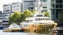 £16 million superyacht wrapped in gold docks at Canary Wharf