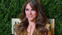 Elizabeth Hurley poses in Versace dress she famously wore on the red carpet 21 years ago