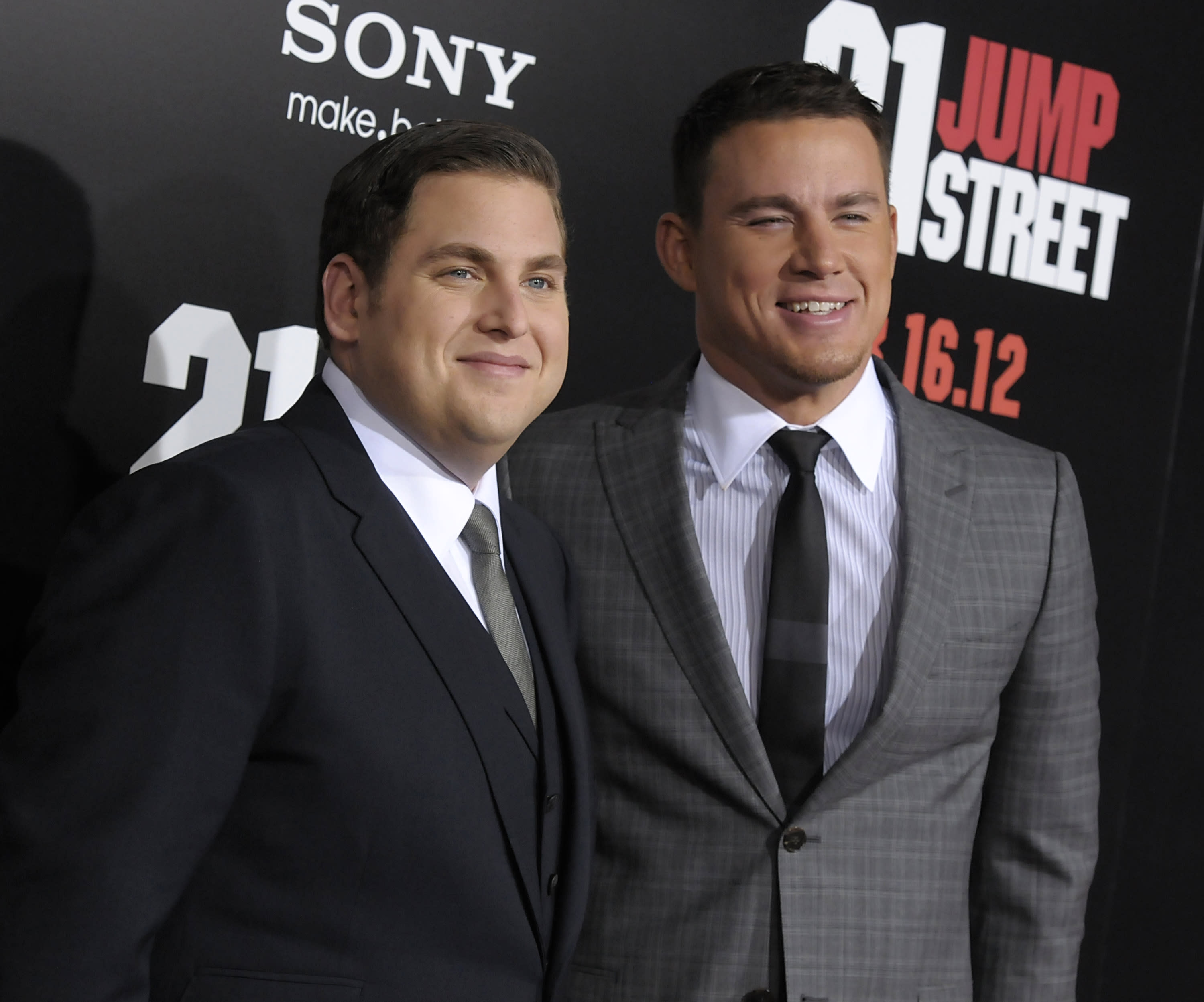 """Actor Jonah Hill, left, and actor Channing Tatum arrive at the premiere of the feature film """"21 Jump Street"""" in Los Angeles on Tuesday, March 13, 2012. (AP Photo/Dan Steinberg)"""