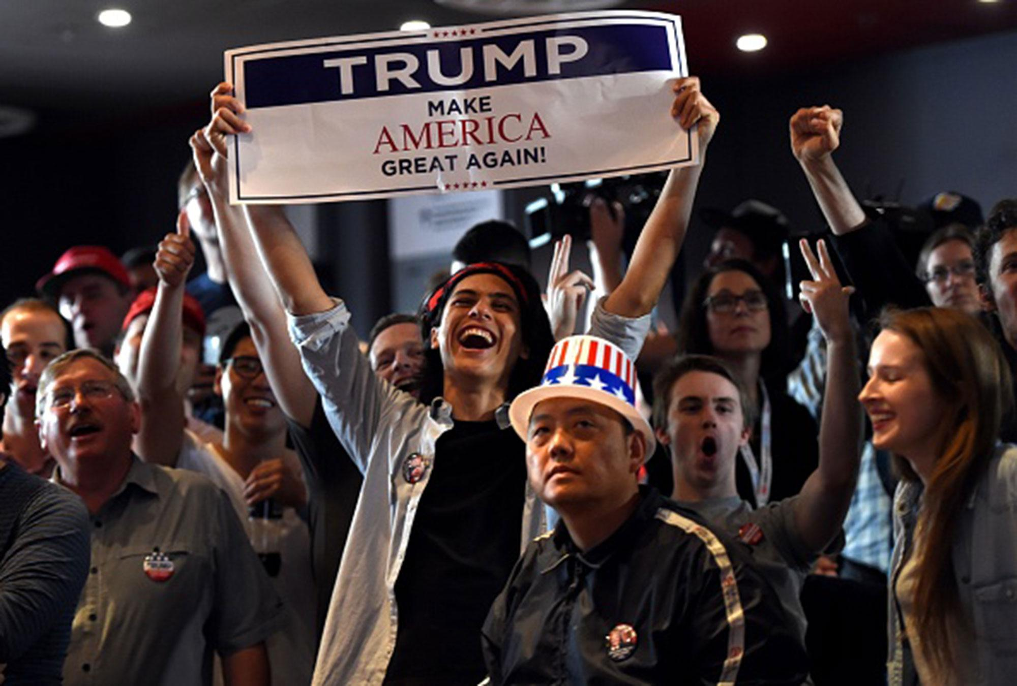 <p>Supporters of U.S. Republican candidate Donald Trump celebrate as they watch results at the United States Studies Center at the University of Sydney on November 9, 2016. (Photo: Saeed Khan/AFP/Getty Images) </p>