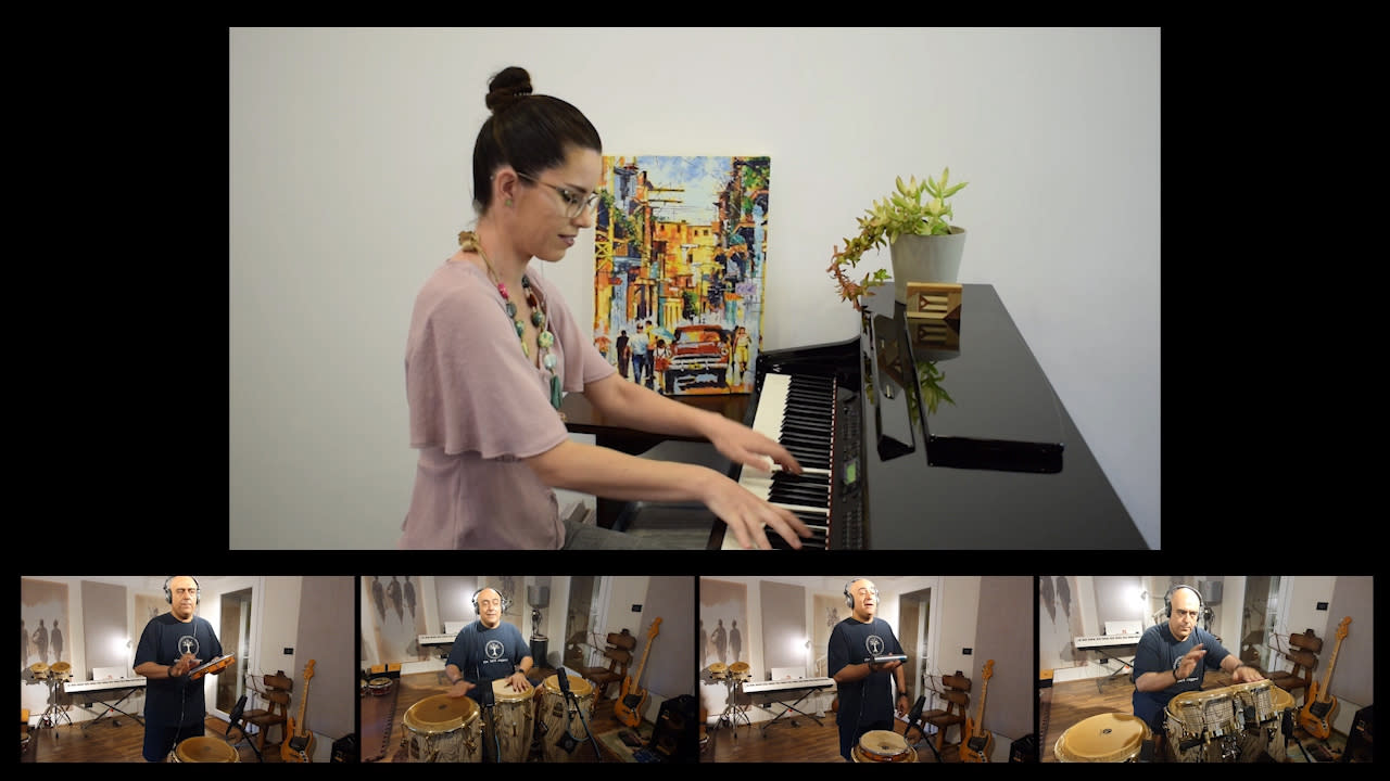 In this image taken from video, pianist Veronica Bievz and percussionist Diaa Badr play the musical accompaniment for a song that was performed by the Cairo Celebration Choir and posted online Aug. 20, 2020, in Cairo. With the help of a sound engineer who combined the individually recorded parts of the performance, musicians, choir members and soloists put out a hopeful message amid the gloom of the pandemic. (Cairo Celebration Choir via AP)