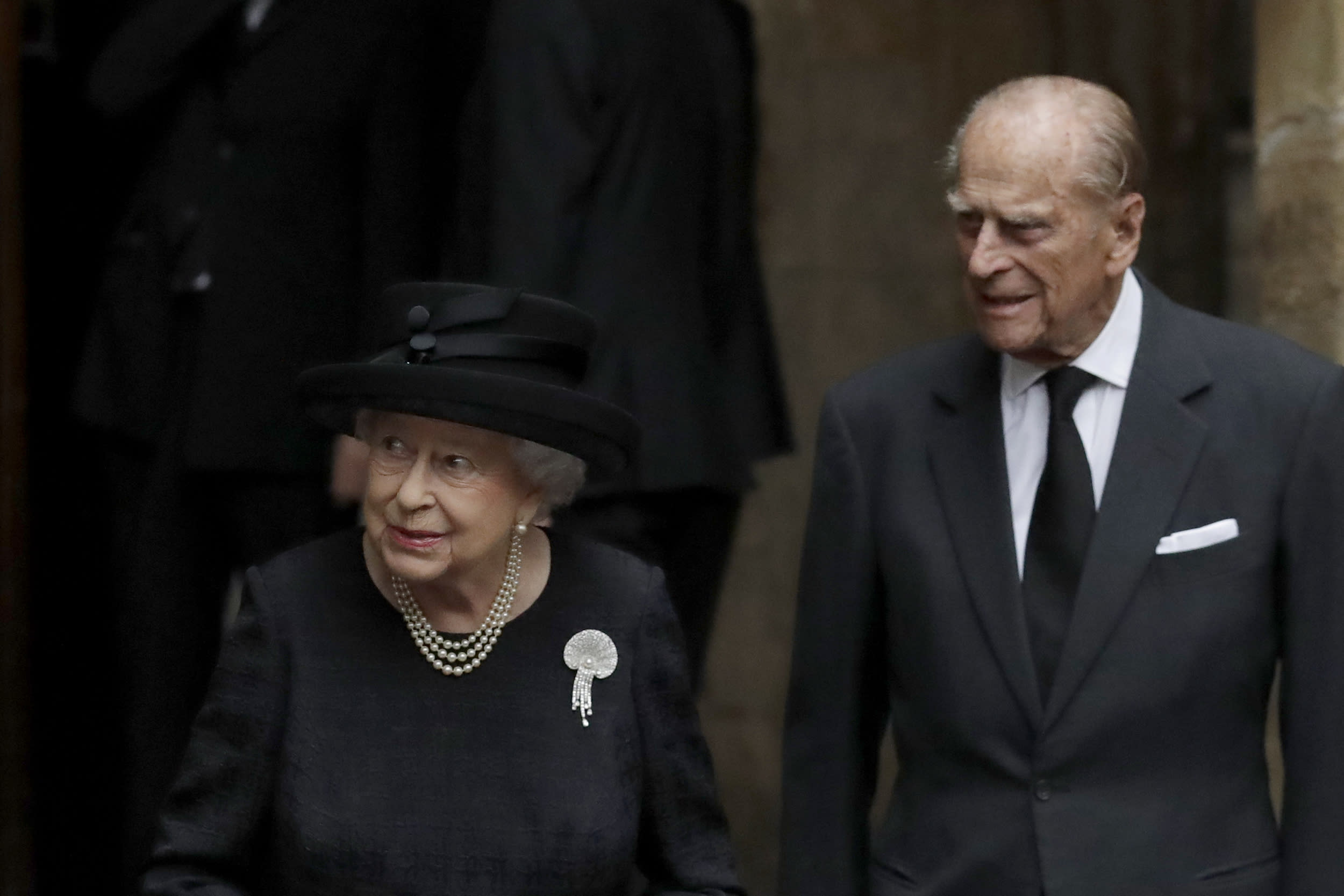 Britain's Queen Elizabeth II and her husband Prince Philip leave after attending the funeral service of Patricia Knatchbull, the Countess Mountbatten of Burma at St Paul's Church in Knightsbridge, London, Tuesday, June 27, 2017. (AP Photo/Matt Dunham, Pool)