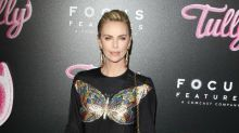 Charlize Theron excited about royal wedding