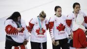 Canadian hockey player apologizes for taking off silver medal