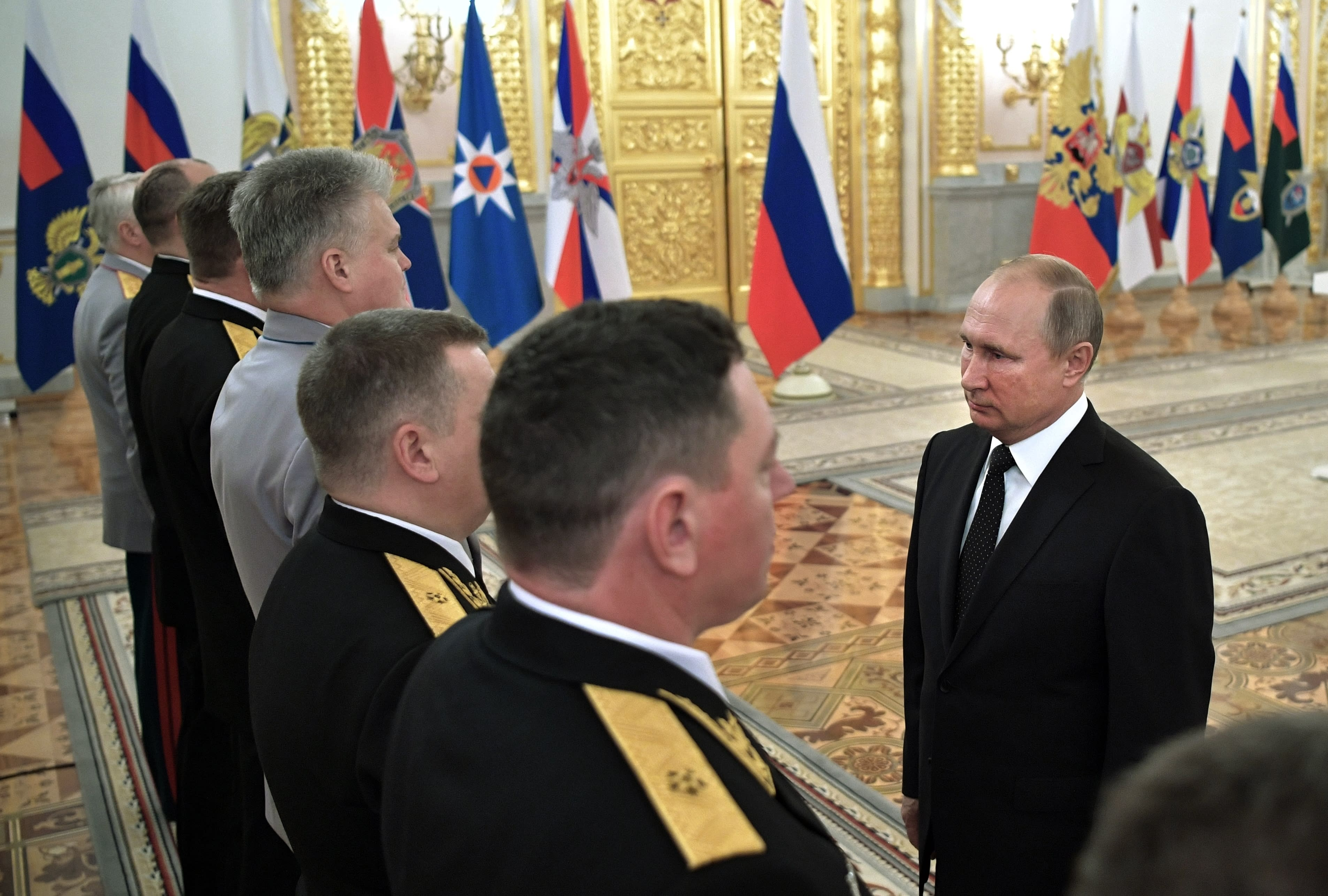 Russian President Vladimir Putin, right, greets top military officers and law enforcement officials in the Kremlin in Moscow, Russia, Thursday, Oct. 25, 2018. Putin said that Russia has adhered to its obligations in the arms control sphere, but noted that Russian arsenals will be modernized to ensure protection from any potential threats. (Alexei Nikolsky, Sputnik, Kremlin Pool Photo via AP)
