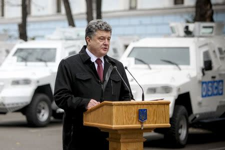 Ukrainian President Poroshenko attends a ceremony to hand over armoured vehicles to OSCE in Kiev