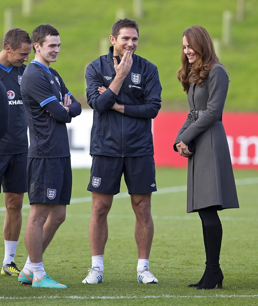 Back in the UK, Kate and Wills attend the official launch of the new Football Centre, the Duchess wearing a Reiss coat.