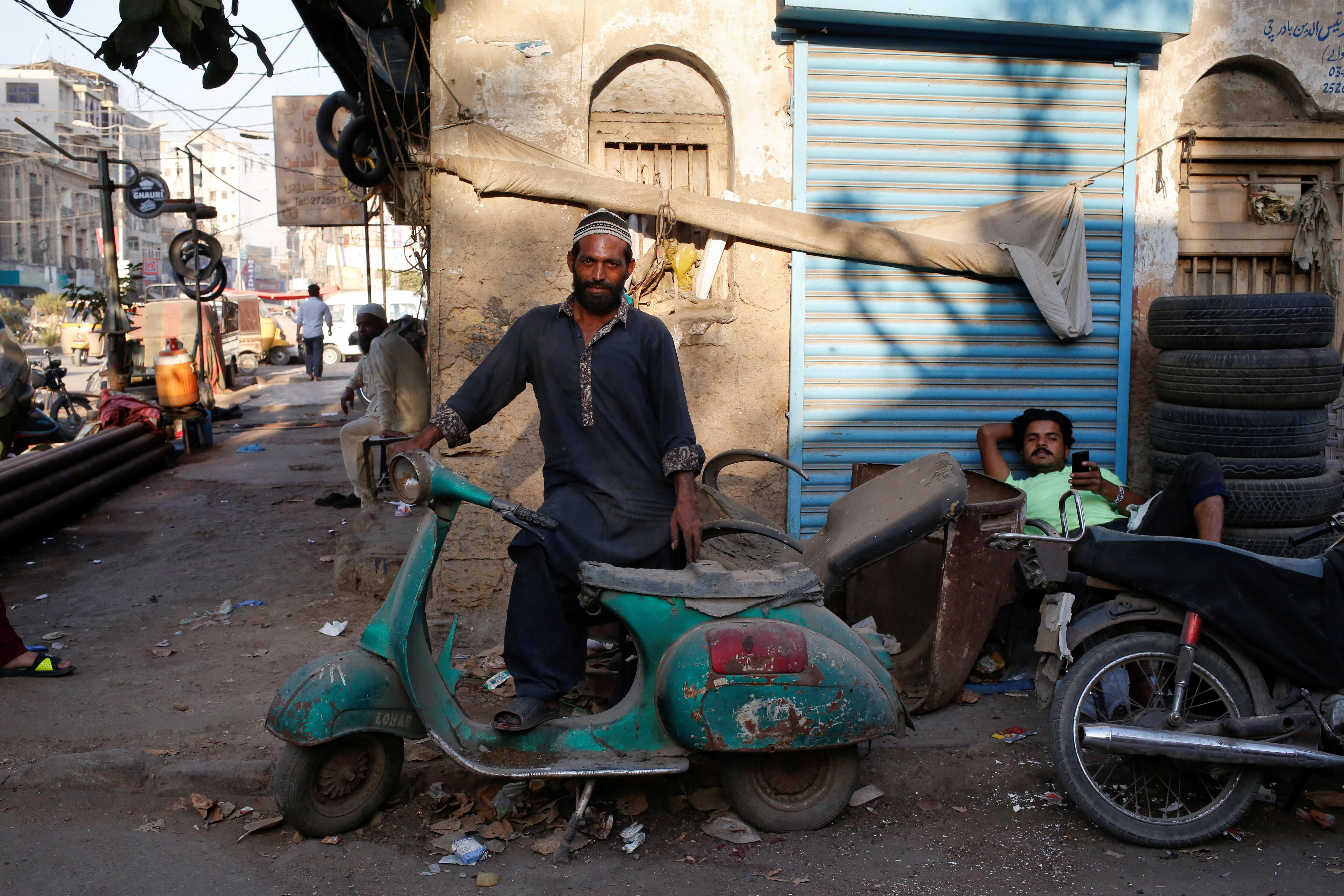 <p>Shahzad stands with his abandoned Vespa scooter in Karachi, Pakistan March 6, 2018. (Photo: Akhtar Soomro/Reuters) </p>