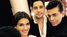Sidharth Malhotra, Kriti Sanon and Karan Johar walk the ramp for Manish Malhotra in Dubai