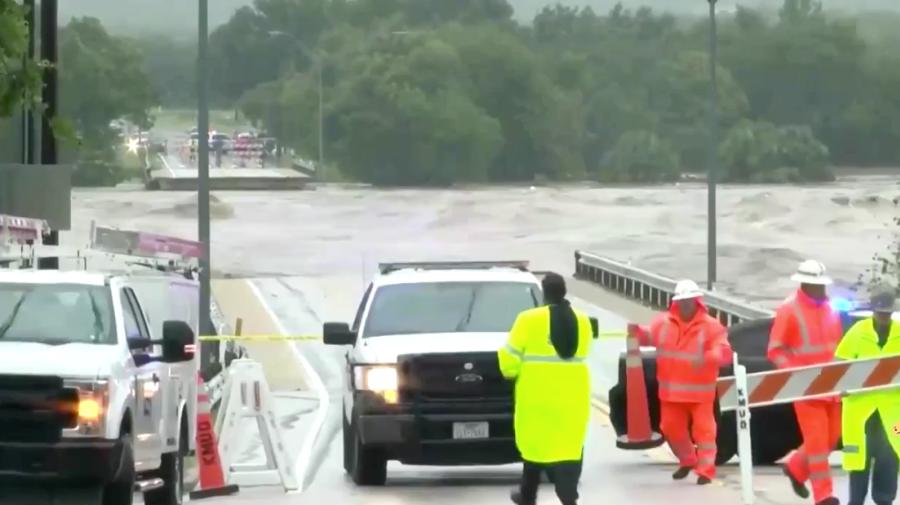 Floods destroy bridge, force evacuations in Texas
