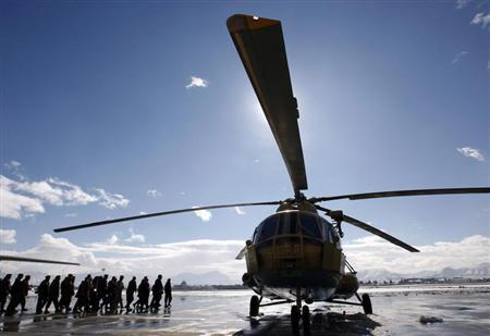 An Afghan Defence Ministry delegation approaches a refurbished newly arrived MI-17 helicopter at the military airport in Kabul January 17, 2008. REUTERS/Ahmad Masood