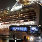 Passengers disembark from cruise ship as Japan announces 2 new deaths