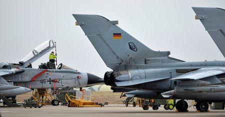 FILE PHOTO: A technician works on a German Tornado jet at the air base in Incirlik, Turkey, January 21, 2016. REUTERS/Tobias Schwarz/Pool/File Photo