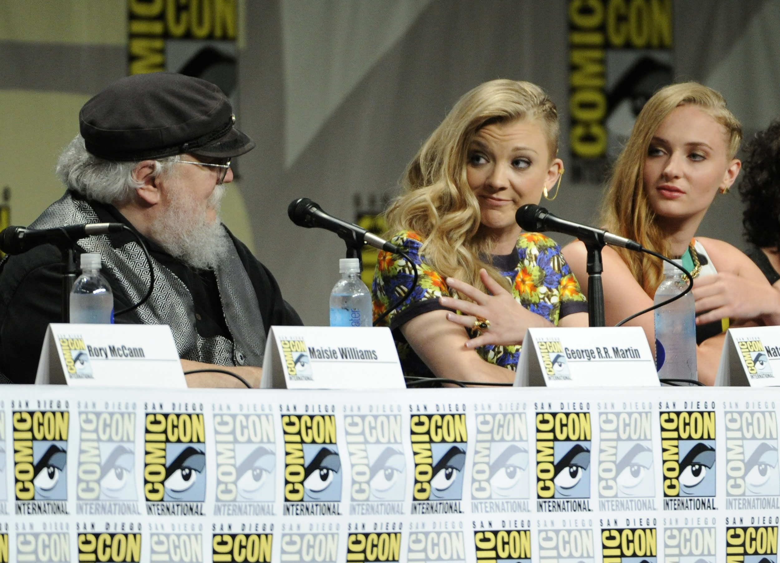 """George R.R. Martin, and from left, Natalie Dormer and Sophie Turner attend the """"Game of Thrones"""" panel on Day 2 of Comic-Con International on Friday, July 25, 2014, in San Diego. (Photo by Chris Pizzello/Invision/AP)"""
