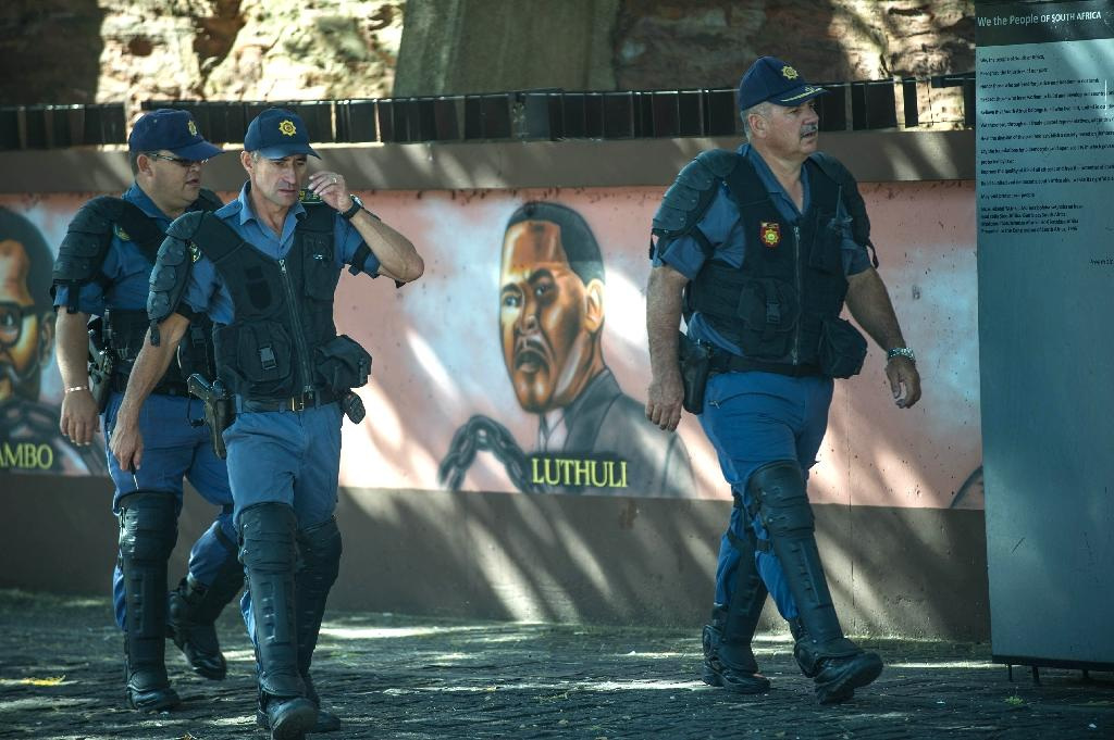 South Africa's serious crime unit, the National Hawks, told local media that they have arrested four people suspected of attempting to join the Islamic State terrorist group (AFP Photo/Mujahid Safodien)