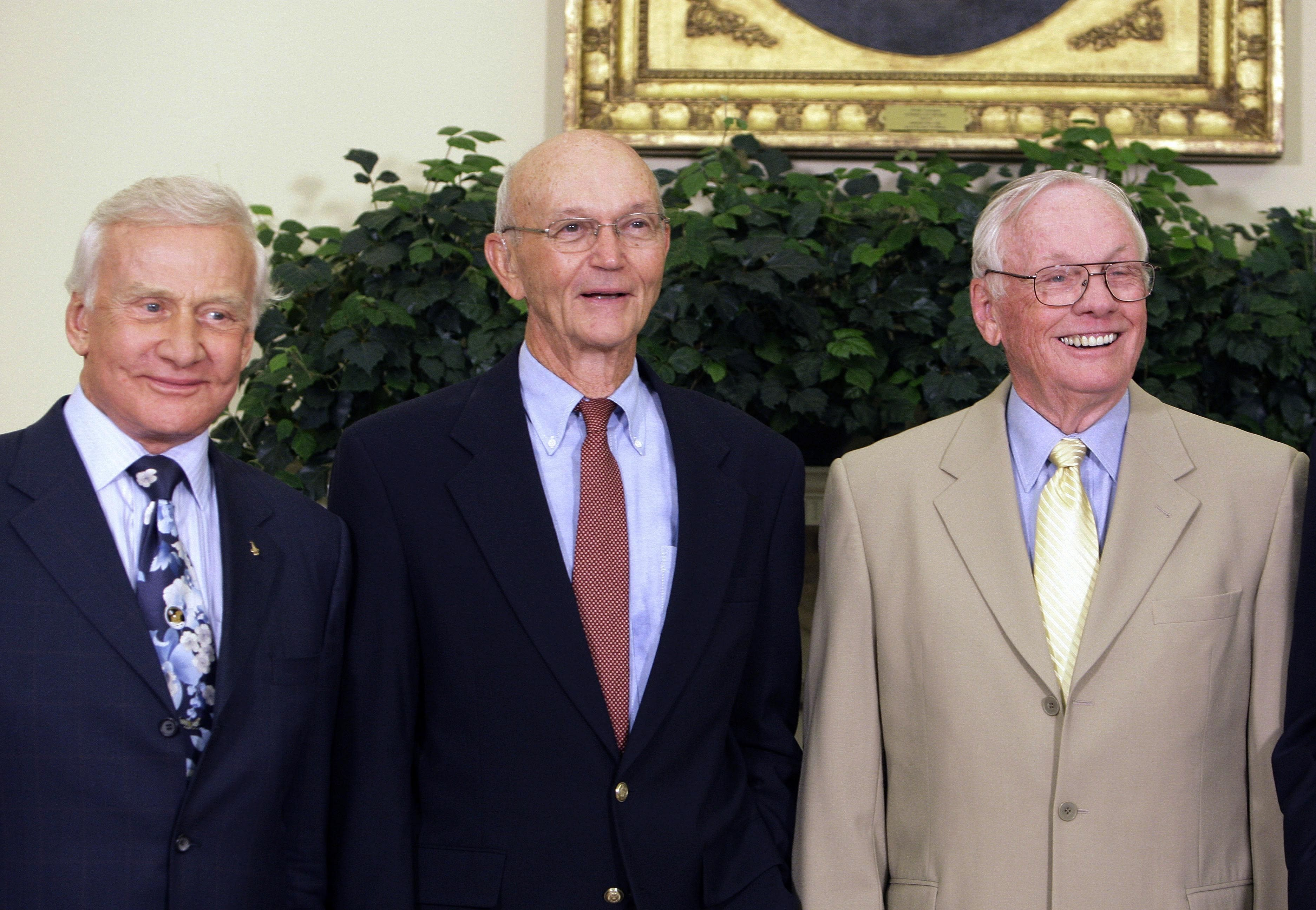 In this July 20, 2009 file photo, Apollo 11 astronauts, from left, Buzz Aldrin, Michael Collins and Neil Armstrong stand in the Oval Office at the White House in Washington, on the 40th anniversary of the mission's moon landing. (AP Photo/Alex Brandon)