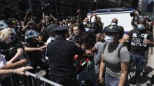 NYPD chief, protesters roughed up in Brooklyn Bridge clash