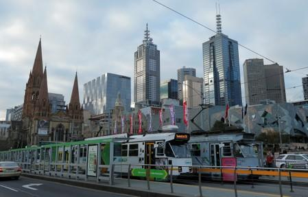 Trams pass by Melbourne's city skyline in Australia's second-largest city