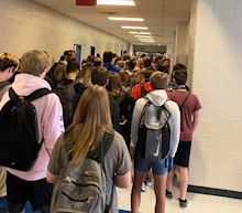Photos of mask-less students crammed into a Georgia school hallway show how difficult reopenings could be