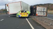 Police close road in Scotland after lorry 'topples onto patrol car' during high winds