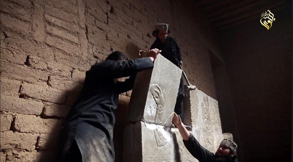 An image from a video from Jihadist media outlet Welayat Nineveh on April 11, 2015 allegedly shows members of the Islamic State group destroying a stoneslab at what they said was the ancient Assyrian city of Nimrud