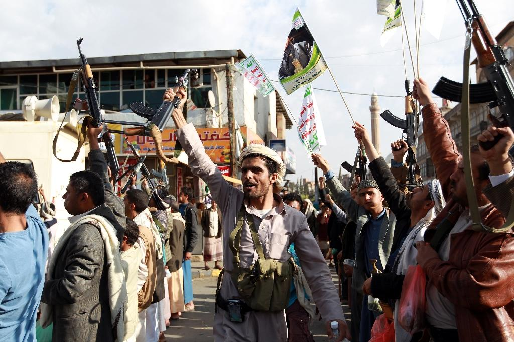 Tribal gunmen loyal to the Huthi movement brandish their weapons in the capital Sanaa on April 1, 2015, during a demonstration against the Saudi-led coalition's operation
