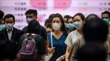 Success story Hong Kong reimposes tough new virus restrictions
