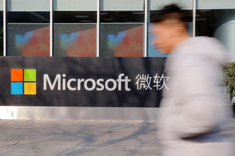A man walks past the office of Microsoft in Beijing