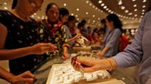 Gold inches up on weaker dollar, inflation outlook