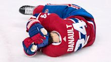 Canadiens' Danault leaves on stretcher after taking Chara slap shot to head