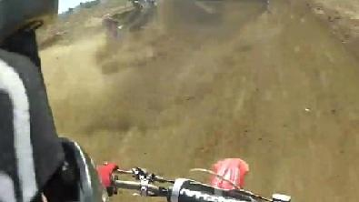 Motocross Biker Lands On Racer