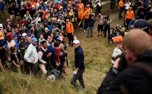 Jordan Spieth stands over his ball on a steep hill on 13. (REUTERS)