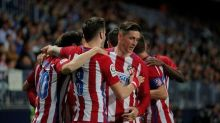 Injury-hit Atletico beat Malaga but Real Sociedad lose ground