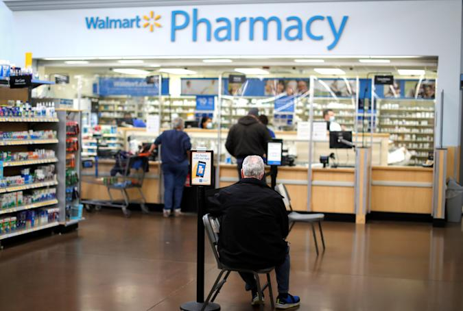 A person waits at a Walmart Pharmacy where the Moderna coronavirus disease (COVID-19) vaccine is available as Walmart and other major U.S. pharmacies take part in the Federal Retail Pharmacy Program, to increase vaccinations in the U.S. in West Haven, Connecticut, U.S., February 17, 2021. REUTERS/Mike Segar