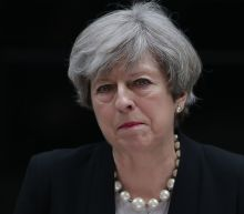 Theresa May reacts to the Manchester Arena attack