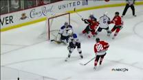 Patrick Kane fires the OT winner past Miller