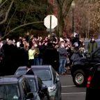 Crowd cheers as Biden leaves Georgetown church