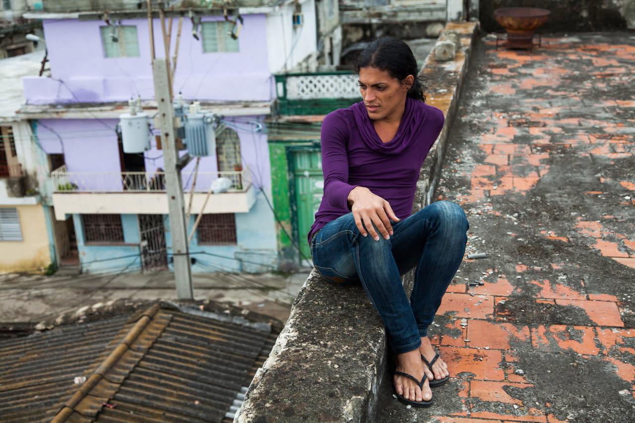 <p>Malu on a roof in Havana<i>. (Photo: Mariette Pathy Allen)</i></p>