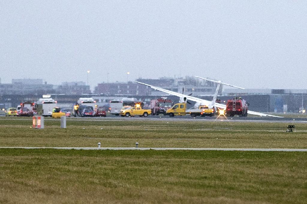 Emergency vehicles arrive as a plane veers off the runway amid a storm at Schiphol Airport on February 23, 2017