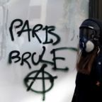 French PM plans new security measures after Champs Elysees rioting
