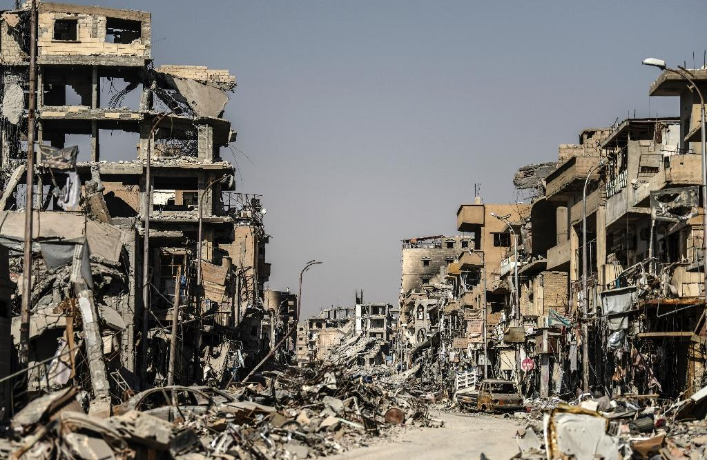 A picture taken on October 21, 2017 shows a general view of heavily damaged buildings in Raqa, after a Kurdish-led force expelled the Islamic State group from the northern Syrian city