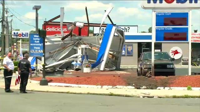 Car Launches Onto Gas Station Roof