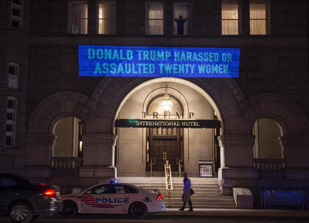 The latest projection by artist Robin Bell on the Trump International Hotel in Washington was timed to coincide with the president's State of the Union address (AFP Photo/Andrew CABALLERO-REYNOLDS)