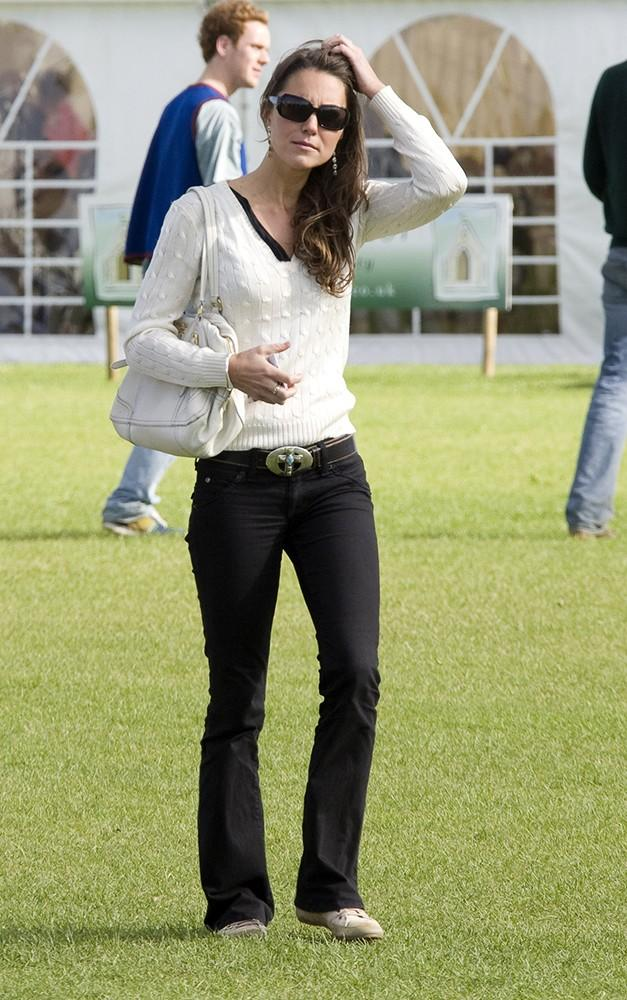 Always there to support, Kate watched Wills and Harry play in a charity polo match.