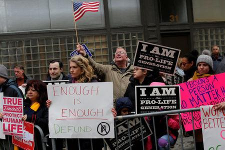 People gather during an anti-Planned Parenthood vigil outside the Planned Parenthood - Margaret Sanger Health Center in Manhattan, New York, U.S., February 11, 2017. REUTERS/Andrew Kelly
