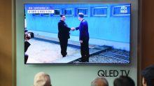 Two Koreas' leaders in historic handshake