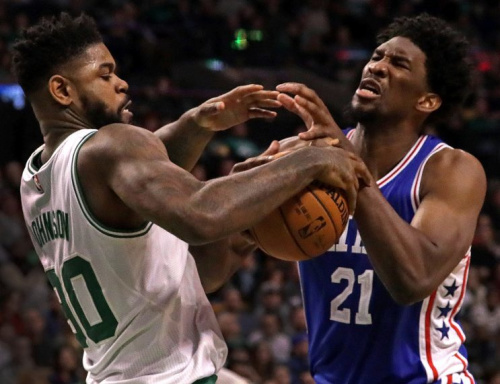 Amir Johnson gets acquainted with future teammate Joel Embiid. (Getty)
