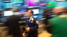 Higher US bond yields weigh on Wall Street stocks, lift dollar